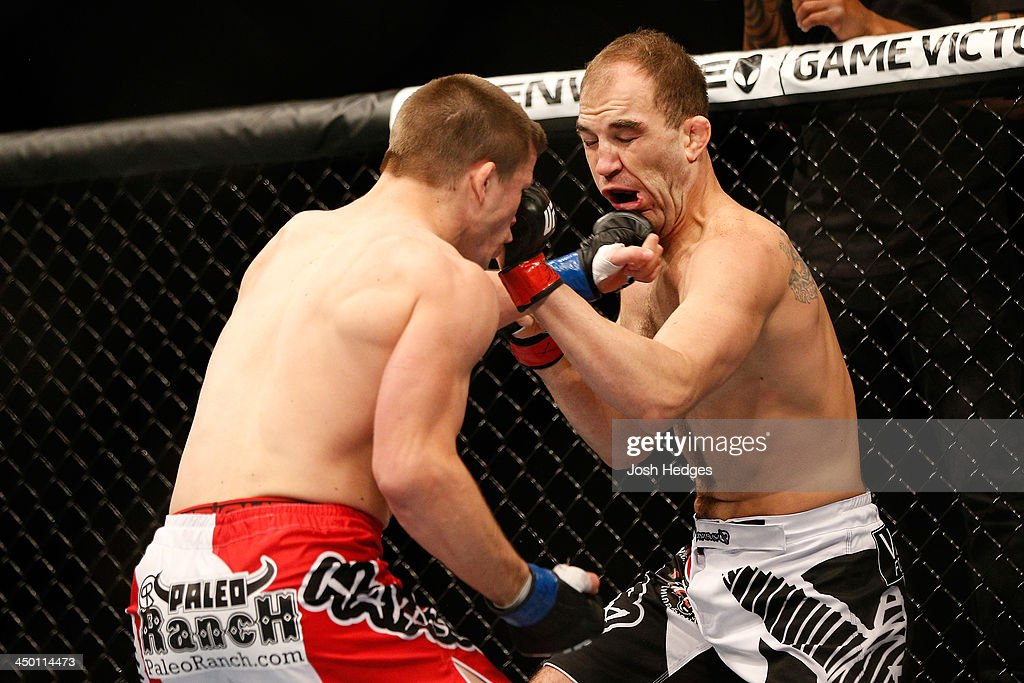 Rick Story punches Brian Ebersole in their welterweight bout during the UFC 167 event inside the MGM Grand Garden Arena on November 16, 2013 in Las Vegas, Nevada.