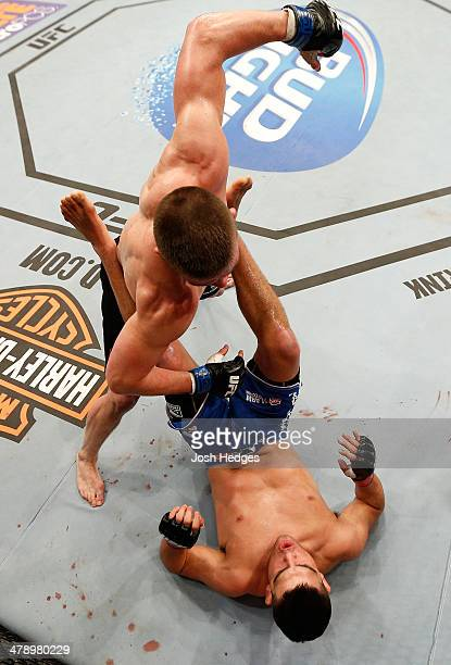 Rick Story punches Kelvin Gastelum in their welterweight bout at UFC 171 inside American Airlines Center on March 15 2014 in Dallas Texas