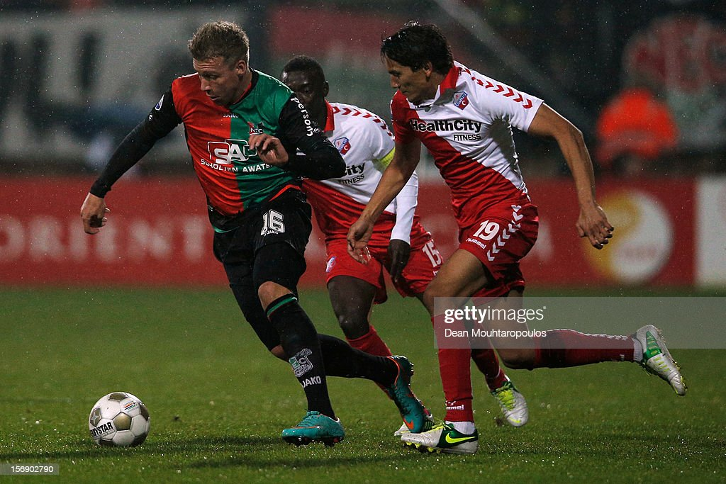 Rick ten Voorde (#16) of NEC gets past Adam Sarota (#19) of Utrecht during the Eredivisie match betwee NEC Nijmegen and FC Utrecht at the McDOS Goffertstadion on November 24, 2012 in Nijmegen, Netherlands.