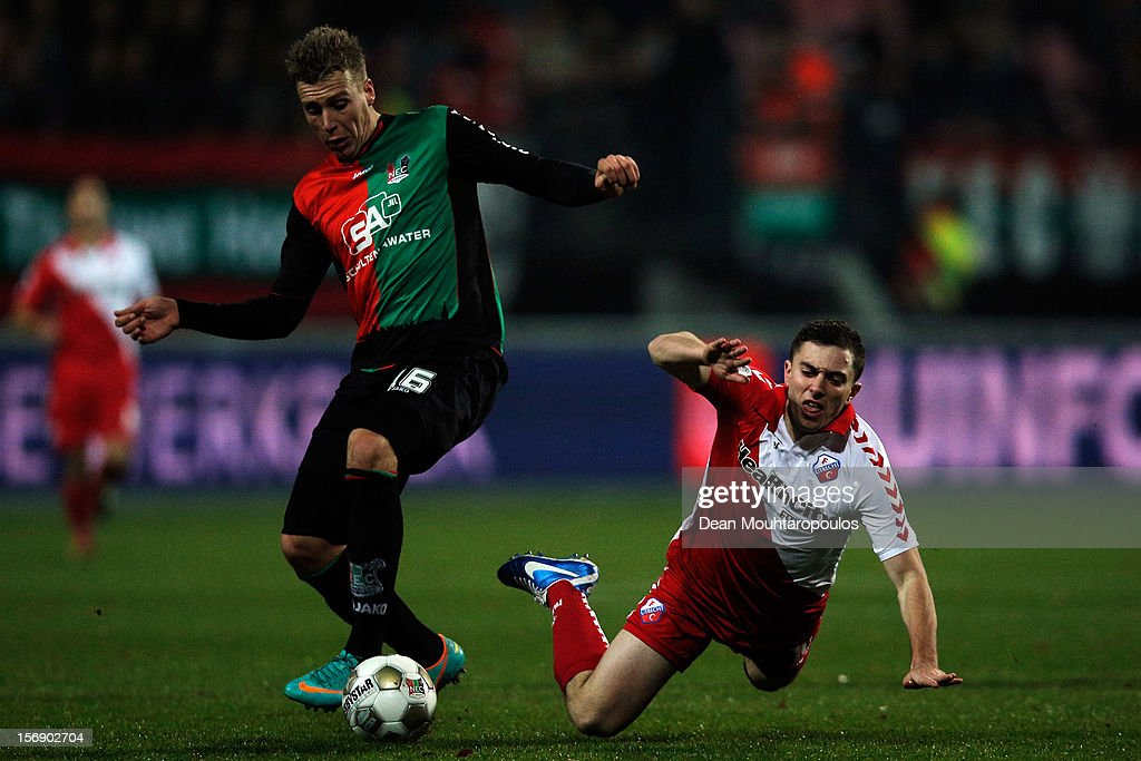 Rick ten Voorde of NEC pushes Tommy Oar of Utrecht off the ball during the Eredivisie match between NEC Nijmegen and FC Utrecht at the McDOS Goffertstadion on November 24, 2012 in Nijmegen, Netherlands.