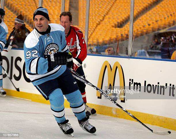 Rick Tocchet of the Pittsburgh Penguins skates against the Washington Capitals during the 2011 NHL Winter Classic Alumni Game on December 31 2010 at...