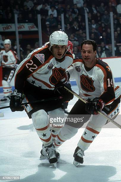 Rick Tocchet of the Wales Conference and the Pittsburgh Penguins and teammate Brad Marsh of the Ottawa Senators skate on the ice during the 1993 44th...