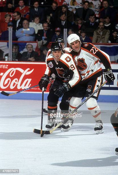 Rick Tocchet of the Wales Conference and the Pittsburgh Penguins defends against Mike Modano of the Campbell Conference and the Minnesota North Stars...