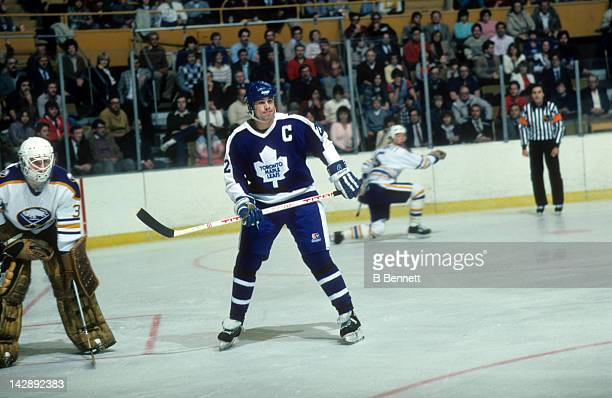 Rick Vaive of the Toronto Maple Leafs skates in front of goalie Tom Barrasso of the Buffalo Sabres on November 11 1983 at the Buffalo Memorial...
