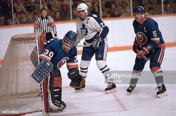 Rick Vaive of theToronto Maple Leafs watches the play with Kelly Hrudey and Denis Potvin of the New York Islanders March 2 1985 at Maple Leaf Gardens...