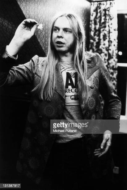 Rick Wakeman of Yes portrait playing darts in a pub and wearing an AM Records tshirt London 1972