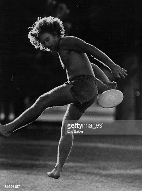 1978 JUL 30 1978 Rick Young of Denver attempts to catch a Frisbee behind his back Frisbee fans insist that the ball lacks mystery now