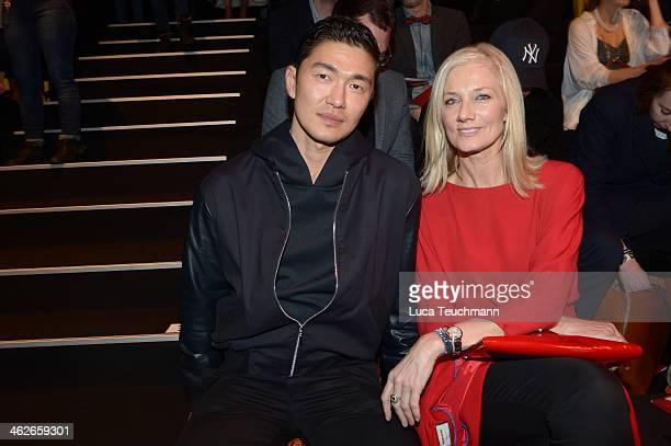 Rick Yune and Joely Richardson attend the Kilian Kerner show during MercedesBenz Fashion Week Autumn/Winter 2014/15 at Brandenburg Gate on January 14...