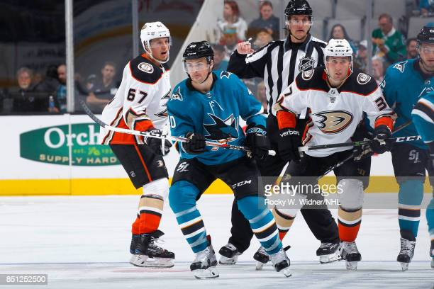 Rickard Rakell and Nick Ritchie of the Anaheim Ducks skate against Ryan Carpenter of the San Jose Sharks at SAP Center on September 19 2017 in San...