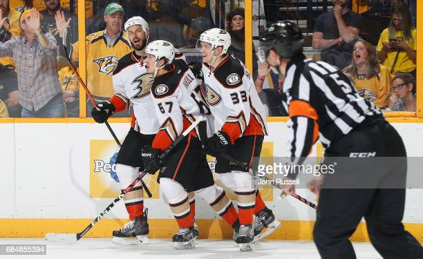 Rickard Rakell celebrates his goal with Ryan Getzlaf and Jakob Silfverberg of the Anaheim Ducks against the Nashville Predators in Game Four of the...