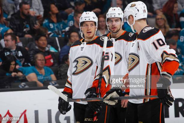 Rickard Rakell Derek Grant and Corey Perry of the Anaheim Ducks talk during the game against the San Jose Sharks at SAP Center on November 4 2017 in...