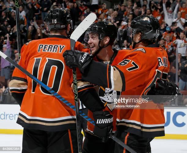 Rickard Rakell Nicolas Kerdiles and Corey Perry of the Anaheim Ducks celebrate Rakell's third period goal against the Boston Bruins on February 22...