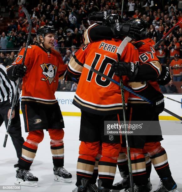 Rickard Rakell Nicolas Kerdiles Corey Perry and Hampus Lindholm of the Anaheim Ducks celebrate Rakell's third period goal against the Boston Bruins...