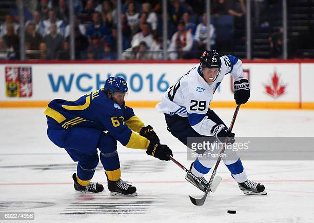Rickard Rakell of Sweden is challenged by Patrik Laine of Finland during the World Cup of Hockey game between Finland and Sweden at the Hartwell...