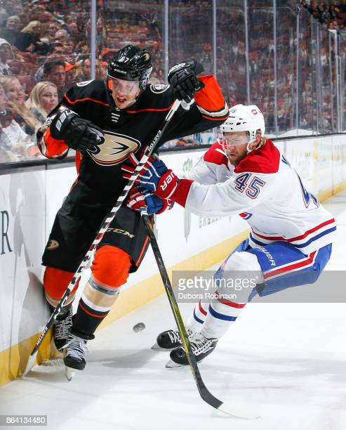 Rickard Rakell of the Anaheim Ducks and Joe Morrow of the Montreal Canadiens battle for the puck during the first period of the game at Honda Center...