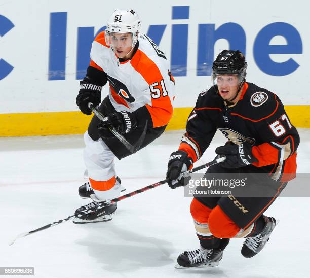 Rickard Rakell of the Anaheim Ducks and Valtteri Filppula of the Philadelphia Flyers skate during the game on October 7 2017 at Honda Center in...