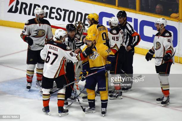 Rickard Rakell of the Anaheim Ducks and Viktor Arvidsson of the Nashville Predators exchange words during the third period in Game Three of the...