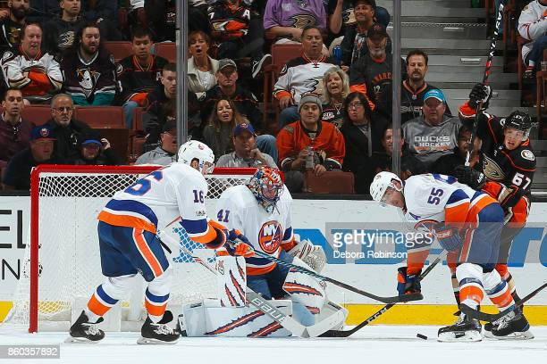 Rickard Rakell of the Anaheim Ducks battles for the puck against Johnny Boychuk Jaroslav Halak and Andrew Ladd of the New York Islanders during the...
