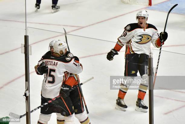 Rickard Rakell of the Anaheim Ducks celebrates with Ryan Getzlaf after scoring a goal against Pekka Rinne of the Nashville Predators as Jakob...