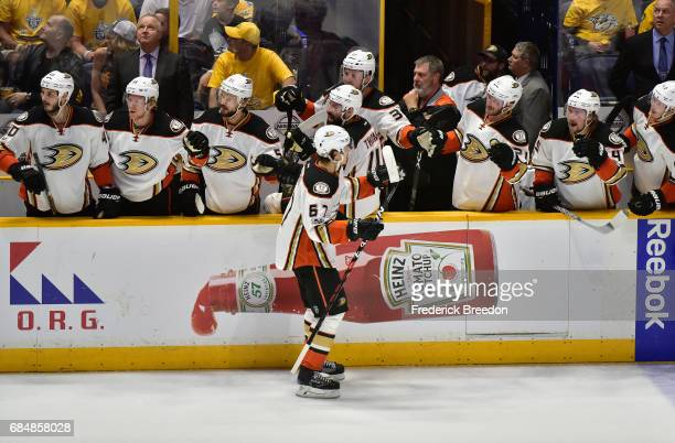 Rickard Rakell of the Anaheim Ducks celebrates with teammates after scoring a goal against Pekka Rinne of the Nashville Predators during the first...