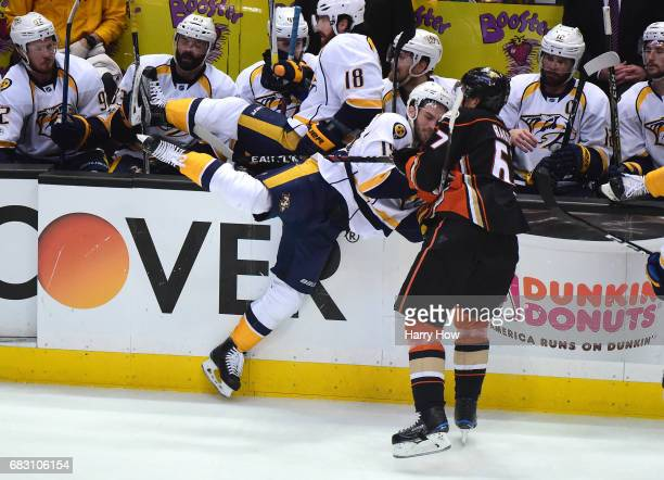 Rickard Rakell of the Anaheim Ducks checks Calle Jarnkrok of the Nashville Predators near the Predators bench in the first period of Game Two of the...