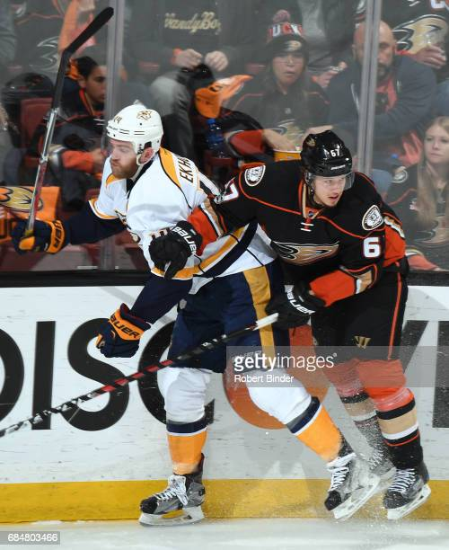 Rickard Rakell of the Anaheim Ducks checks Mattias Ekholm of the Nashville Predators in Game One of the Western Conference Final during the 2017 NHL...