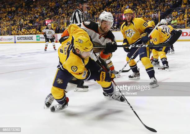 Rickard Rakell of the Anaheim Ducks checks Yannick Weber of the Nashville Predators in Game Four of the Western Conference Final during the 2017 NHL...