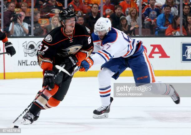 Rickard Rakell of the Anaheim Ducks handles the puck against Benoit Pouliot of the Edmonton Oilers in Game Two of the Western Conference Second Round...