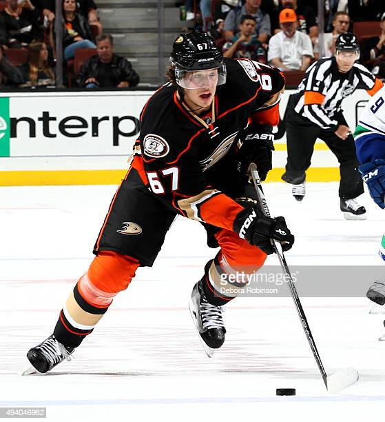 Rickard Rakell of the Anaheim Ducks handles the puck during the game against the Vancouver Canucks on October 12 2015 at Honda Center in Anaheim...