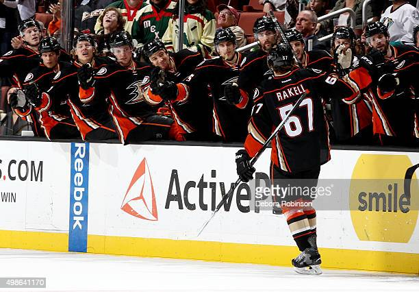 Rickard Rakell of the Anaheim Ducks is congratulated by his teammates after his first period goal against the Calgary Flames on November 24 2015 at...