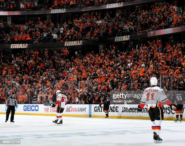 Rickard Rakell of the Anaheim Ducks is congratulated by his teammates after his first period goal during the game against the Calgary Flames in Game...