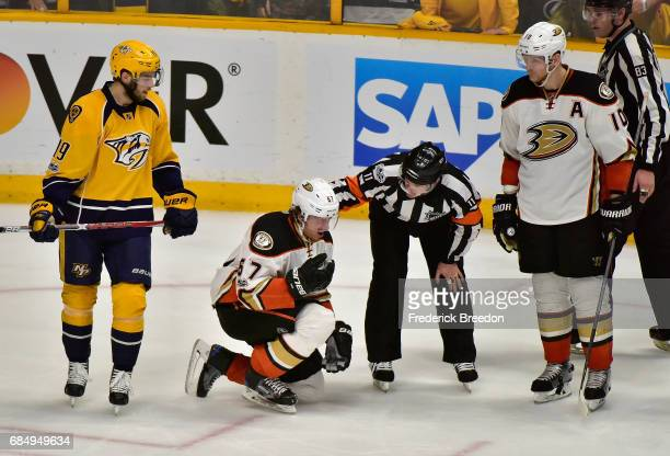 Rickard Rakell of the Anaheim Ducks reacts after being hit in the face during the third period against the Nashville Predators in Game Four of the...