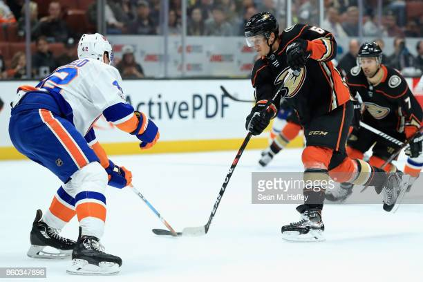 Rickard Rakell of the Anaheim Ducks shoots the puck as Scott Mayfield of the New York Islanders defends during the first period of a game at Honda...