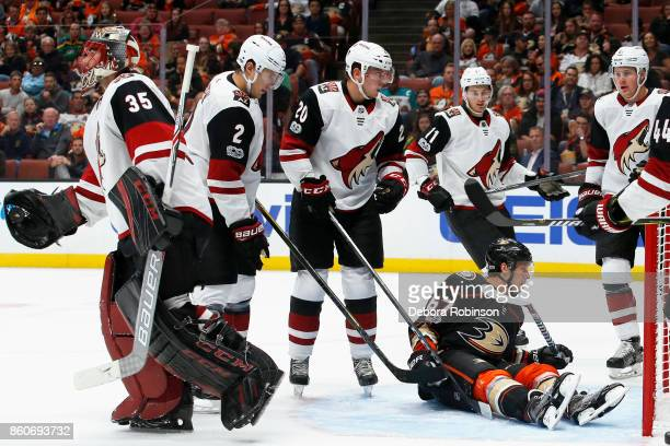 Rickard Rakell of the Anaheim Ducks sits in the crease surrounded by Coyotes after a whistle during the game on October 5 2017 at Honda Center in...