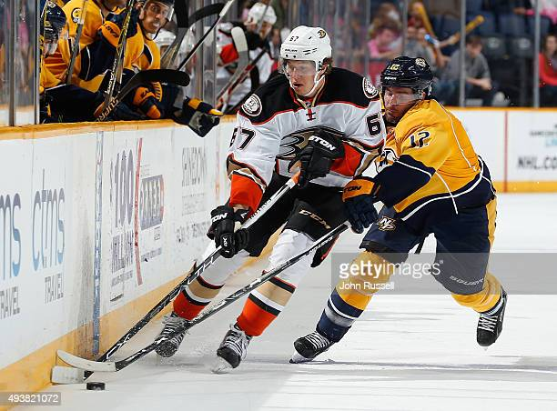 Rickard Rakell of the Anaheim Ducks skates against Mike Fisher of the Nashville Predators during an NHL game at Bridgestone Arena on October 22 2015...
