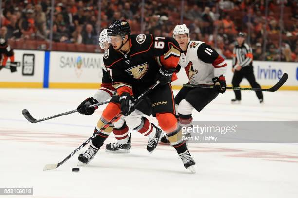 Rickard Rakell of the Anaheim Ducks skates up ice past Christian Dvorak of the Arizona Coyotes during the third period of a game at Honda Center on...