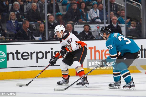Rickard Rakell of the Anaheim Ducks skates with the puck against Logan Couture of the San Jose Sharks at SAP Center on November 4 2017 in San Jose...