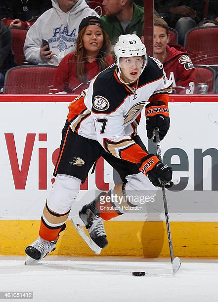 Rickard Rakell of the Anaheim Ducks skates with the puck during the NHL game against the Arizona Coyotes at Gila River Arena on December 27 2014 in...
