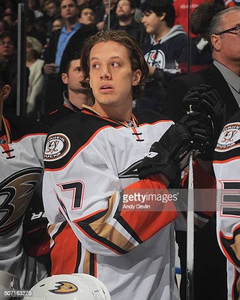 Rickard Rakell of the Anaheim Ducks stands for the singing of the national anthem prior to the game against the Edmonton Oilers on December 31 2015...