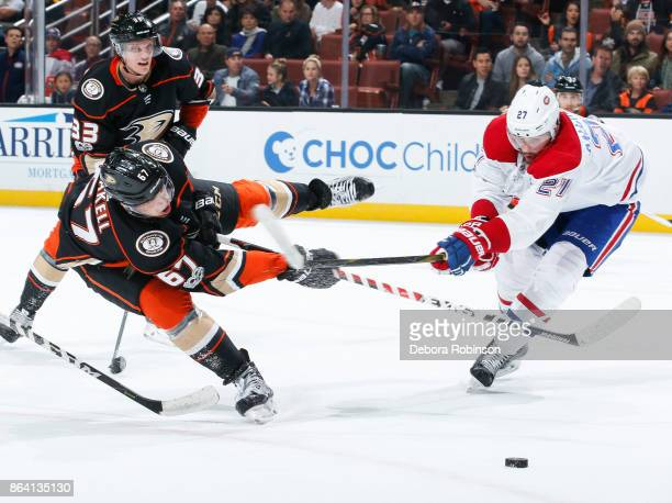 Rickard Rakell of the Anaheim Ducks takes a shot past Alex Galchenyuk of the Montreal Canadiens during the first period of the game at Honda Center...