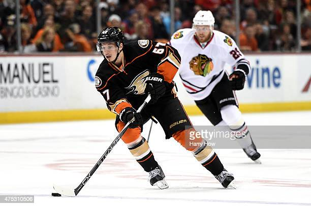 Rickard Rakell of the Anaheim Ducks with the puck ahead of Bryan Bickell of the Chicago Blackhawks in the first period in Game Seven of the Western...