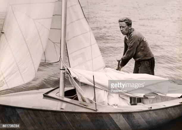 Rickard Sarby of Sweden the eventual fourth place finisher saiing in the Firefly class event during the Summer Olympic Games in Torbay Great Britain...