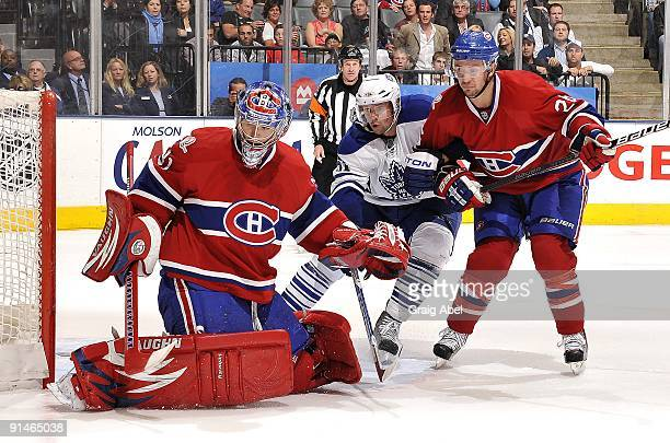 Rickard Wallin of the Toronto Maple Leafs battles for position with Josh Gorges of the Montreal Canadiens in front of goaltender Carey Price of the...