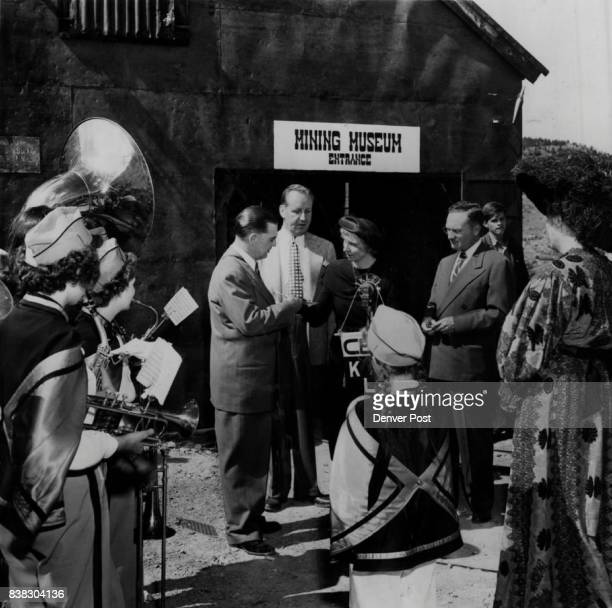 JUL 3 1949 ***** H Ricketson Jr Denver Civic leader Mrs TH Jenks and Mac Switzer of station participate ceremonies in front of the mining museum at...