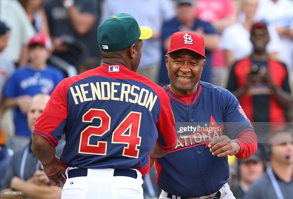 <a gi-track='captionPersonalityLinkClicked' href=/galleries/search?phrase=Rickey+Henderson&family=editorial&specificpeople=202868 ng-click='$event.stopPropagation()'>Rickey Henderson</a> and <a gi-track='captionPersonalityLinkClicked' href=/galleries/search?phrase=Ozzie+Smith&family=editorial&specificpeople=209214 ng-click='$event.stopPropagation()'>Ozzie Smith</a> at the 2014 MLB All-Star legends and celebrity softball game on July 13, 2014 at the Target Field in Minneapolis, Minnesota.