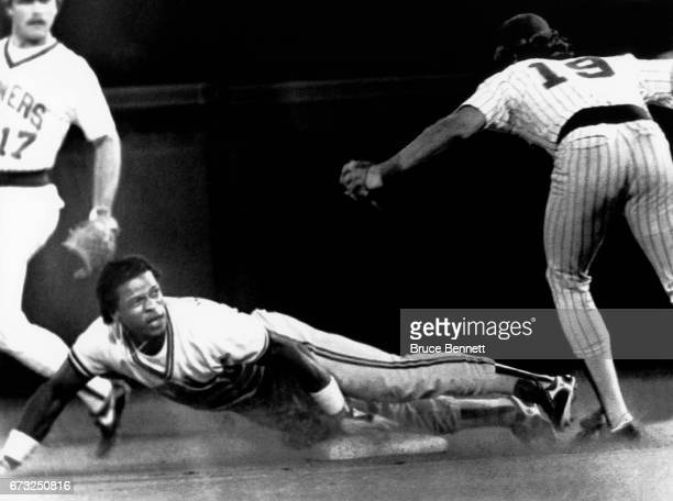Rickey Henderson of the Oakland Athletics is safe at second after stealing his 118th stolen base to tie Lou Brock's record of 118 as Robin Yount and...