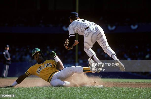 Rickey Henderson of the Oakland Athletics slides to avoid the tag during a 1981 season game