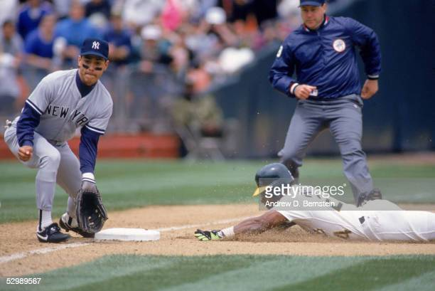 Rickey Henderson of the Oakland Athletics slides to steal third base during a game against the New York Yankees on May 1 1991 at Oakland Alameda...