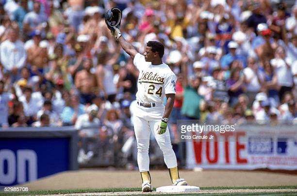 Rickey Henderson of the Oakland Athletics waves to the fans after he stole his 893rd career base surpassing Ty Cobb as the American League's alltime...