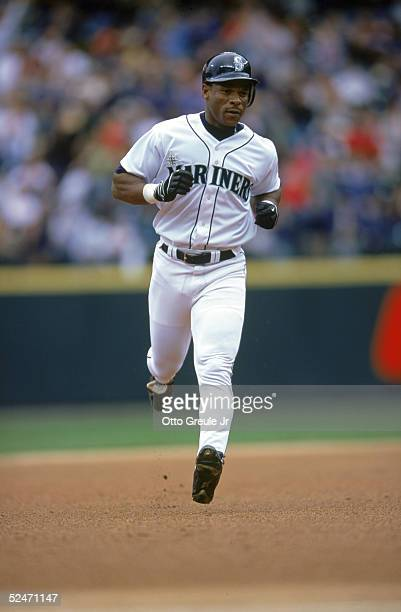 Rickey Henderson of the Seattle Mariners runs the bases during the game against the Tampa Bay Devil Rays at Safeco Field on May 21 2000 in Seattle...